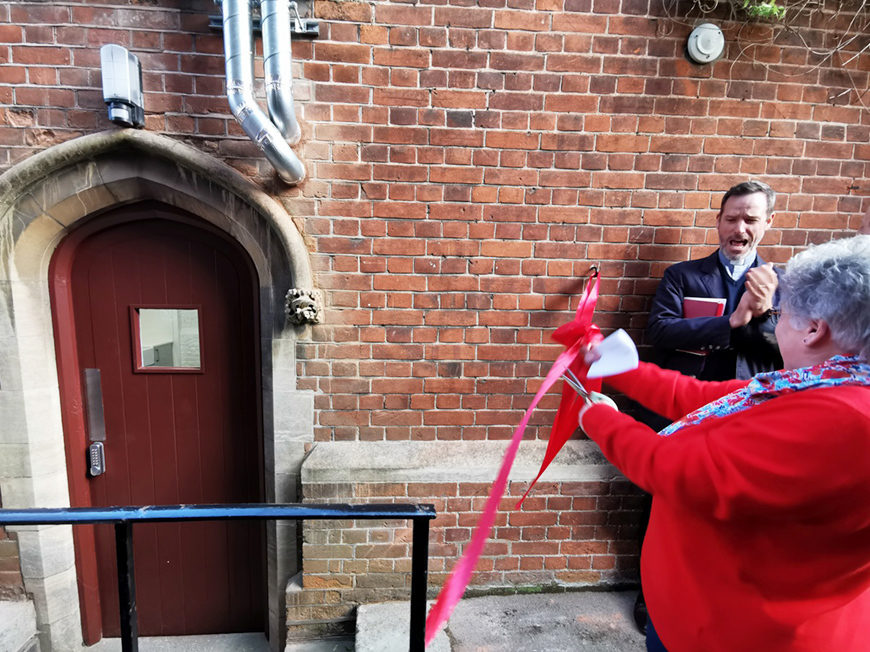 Housekeeping Manager Helen Corley cuts the ribbon