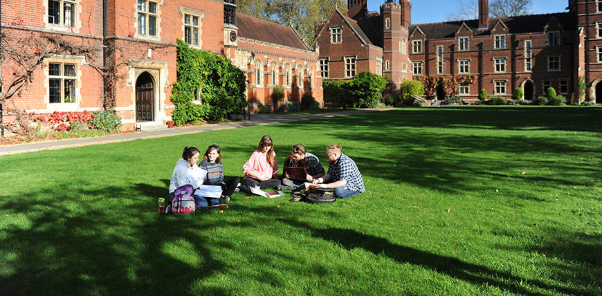 Student group sitting on the lawn
