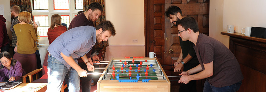 Students playing table football in the common room